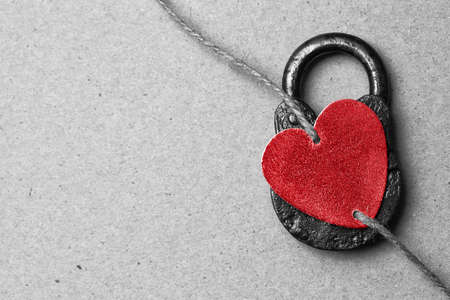 Valentines Day. Red decorative heart on a paper background. Free space for text