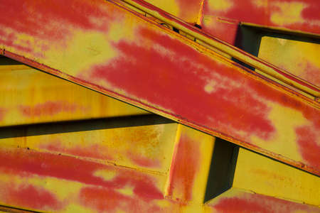 Abstract metal structure closeup of red and yellow. Abstract background, lines Stock Photo