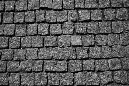 The stone pavement. Pavement of cobblestones. Background. The texture of the stones, free the empty space