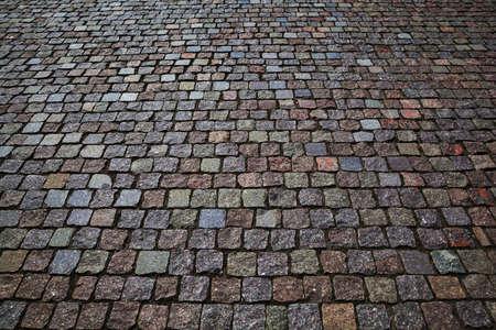 The stone pavement. Pavement of cobblestones. Background, stones texture, free, empty space