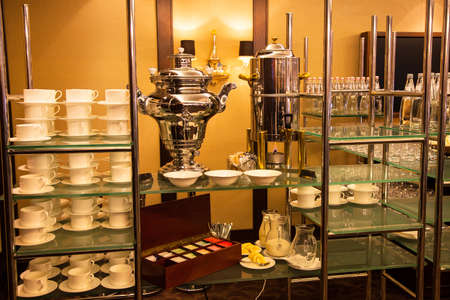 A samovar and a coffee. Self-catering in the banquet hall. Tea, coffee, banquetware