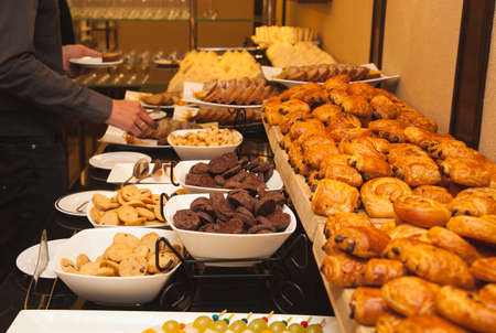 Different kinds of sweets and baked goods at the banquet, self-service