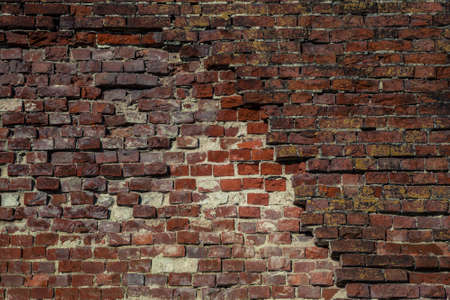 old brick wall with dumped bricks. Background, texture red brick. Vintage style. Space. Background for the designer. old brick masonry wall