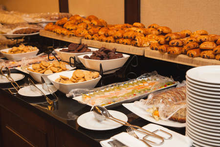 Sweets, fresh pastries, snacks: biscuits, cookies, cheesecakes, cupcakes. Self-service Banquet Stock Photo