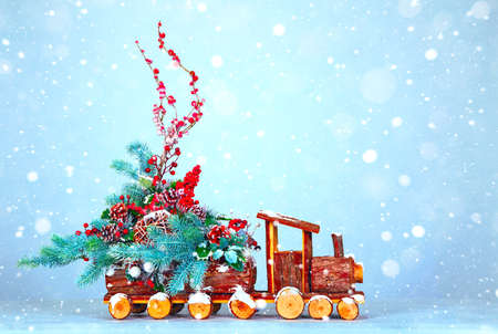Christmas background. New Year. A toy steam locomotive carries New Year decorations. Free space for text