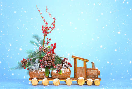 New Year background. The locomotive carries the Christmas tree and Christmas decorations. The snow falls Stock Photo
