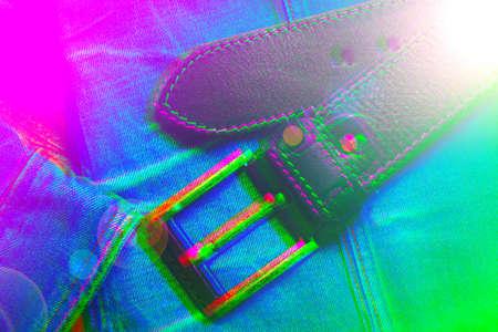 Acid bright background with glitch effect. Fashion background - leather belt and denim jacket