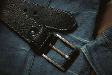 black leather belt. Fashionable casual clothing and accessories closeup, top view, vintage style Stock Photo