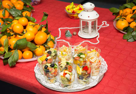 Festive Table: Fruits (tangerines), Snacks, Salads, Sweets ...