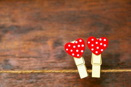 Two hearts on wooden background. Empty space