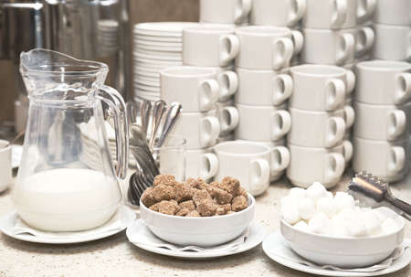 Coffee, sugar, cream, and Cutlery and crockery. Cups for coffee and tea at the Banquet.