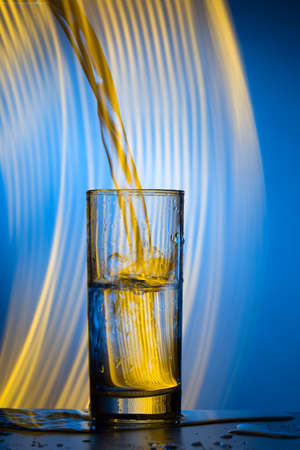 Water pours into the glass. Double exposure, creative photography