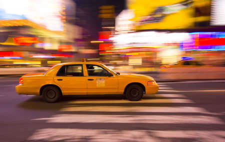 Taxi cab speeding through New York City, with vibrant, motion blur background