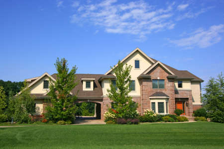 subdivisions: Luxurious executive home with blue sky Stock Photo