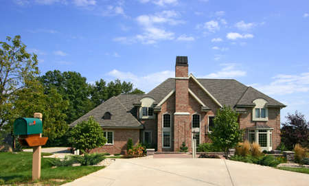 subdivisions: Luxurious executive home with blue sky and mailbox