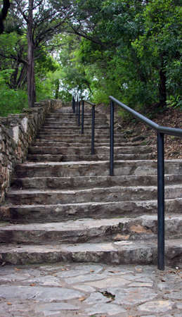 Stone staircase leading up in the woods Stock Photo