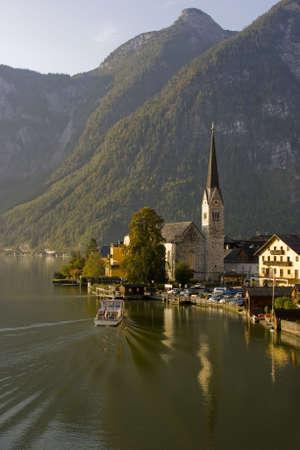 Boat docking in the morning haze in beautiful Hallstatt, Austria
