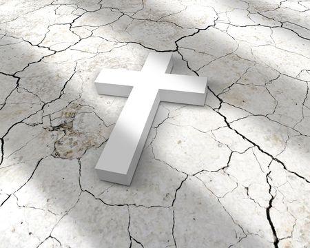 white cross lying on cracks photo