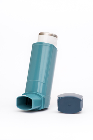 Portable asthma inhaler on a white background