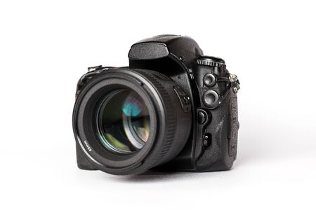 Digital SLR camera with lens on a white background