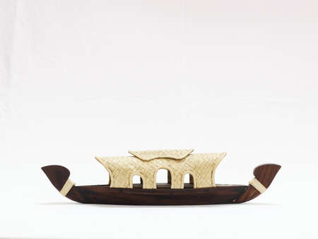 miniature kerala houseboat isolated in a white background