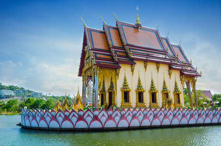 Beautiful asian temple on the river in Thailand photo