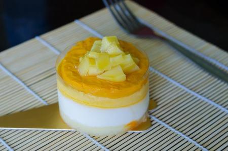 custard slice: Close up of mango mousse cake on yellow background