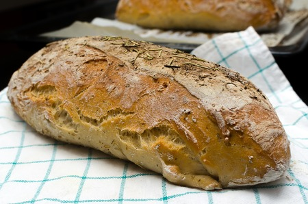 homemade bread: Homemade bread with herbs on a kitchen towel