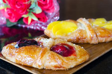 flaky: Sweet flaky pastry with mango and cherry jam