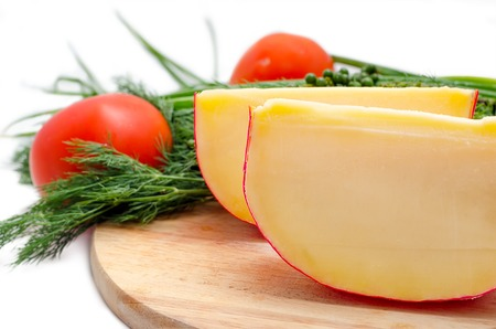 edam: Edam cheese with fennel and tomatoes on a cutting board Stock Photo