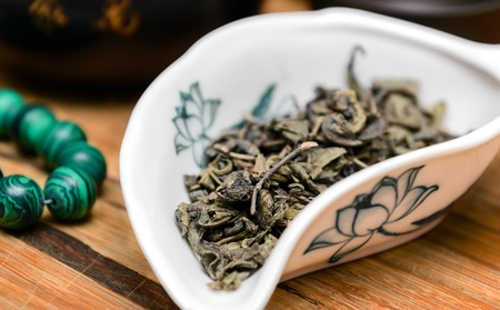 pao: Dry green tea Da Hong Pao on wooden background