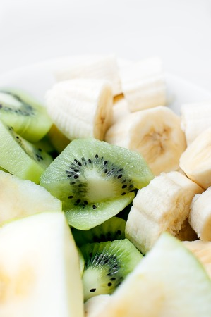 fruition: Fresh fruit in white plate. Close up.