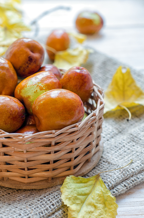 half ball: Fresh jujube or chinese date in a small basket.