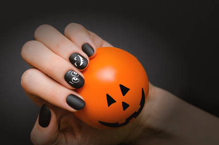 Halloween Nail art design. Black nail polish. Stock Photo - 85272836