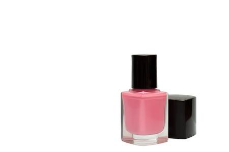Bottle of pink nail polish isolated on white background.