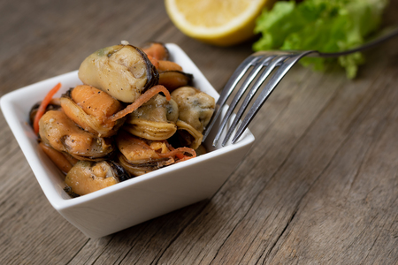 Pickled mussels with carrot, lemon juice and oil.
