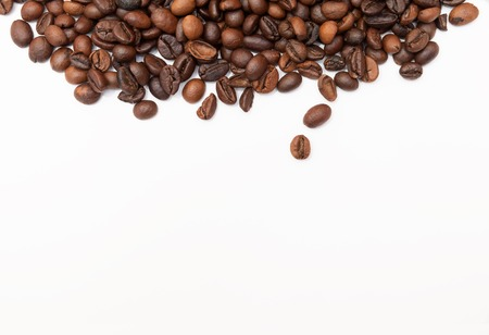 Coffee beans on white background, close up