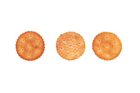 Close up of round crackers on white background