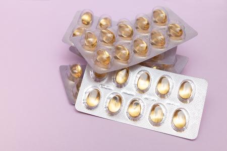Omega 3 oil capsule on a purple background Reklamní fotografie