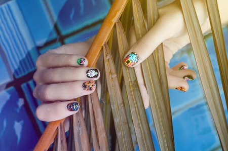 Female hand with color nail art stickers. Reklamní fotografie