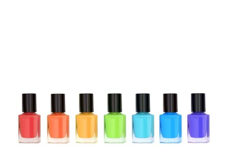 Group of nail polishes isolated on white background, rainbow color