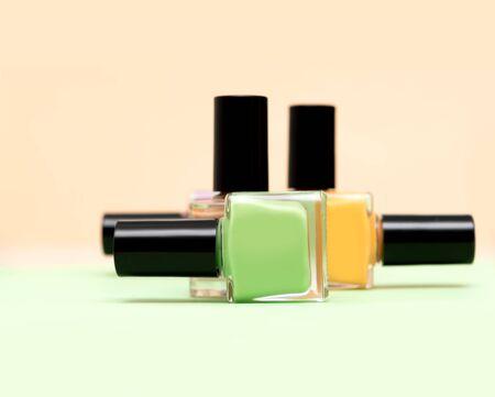 Bottles of nail polish on light background
