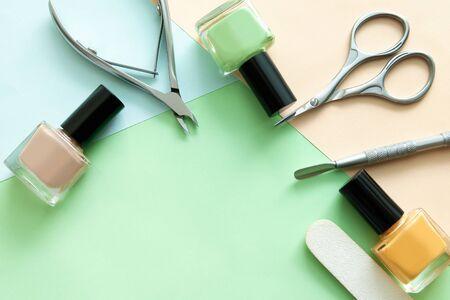 Nail polish bottles and manicure tools. Nail care flat lay