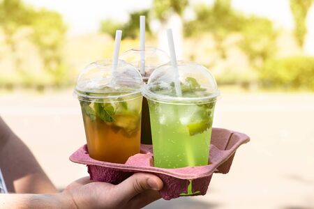 Assortment of Colored Berry Take Away Beverages in plastic cup