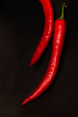 Red Chili peppers on a black background