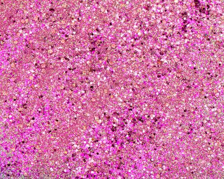 Shiny background with pink glitter close up