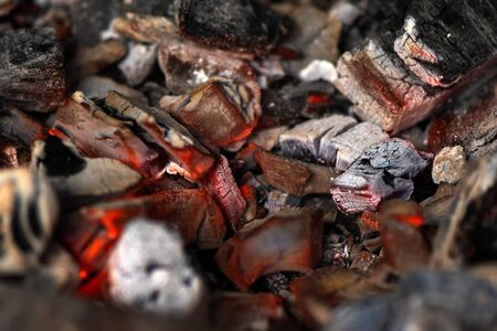 Burning coals in stove for cooking, close up