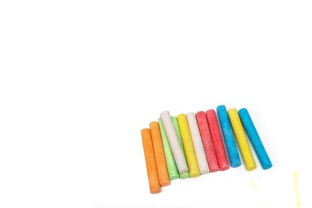 Colored crayons on a white sheet of paper Reklamní fotografie