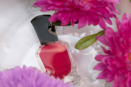 Pink nail polish bottle under the water. 写真素材