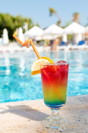 Refreshing coctail near swimming pool, tclose up.